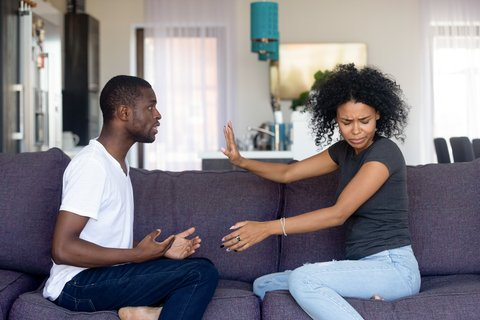 Couple Arguing On Couch - The Silly Things Couple Fight About