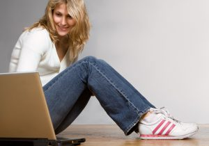 Blonde Girl On Laptop